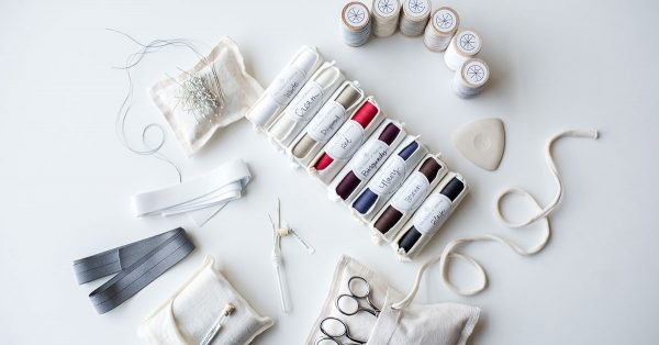 Spools of thread and sewing needles