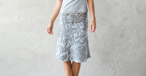 Person modeling a skirt with flower pattern