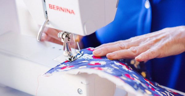 Sewing colorful fabric on a machine