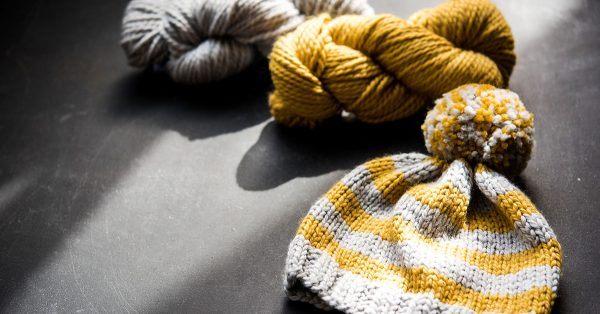 Yellow and grey knit pom hat