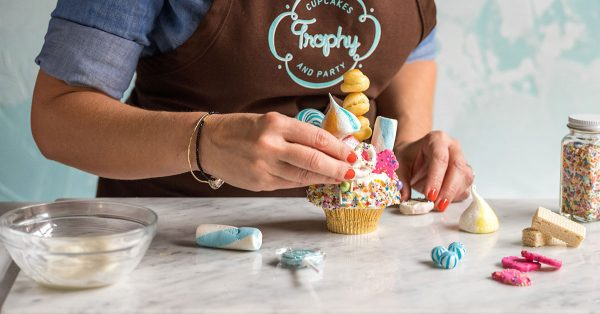 Placing cupcake topper on a cupcake