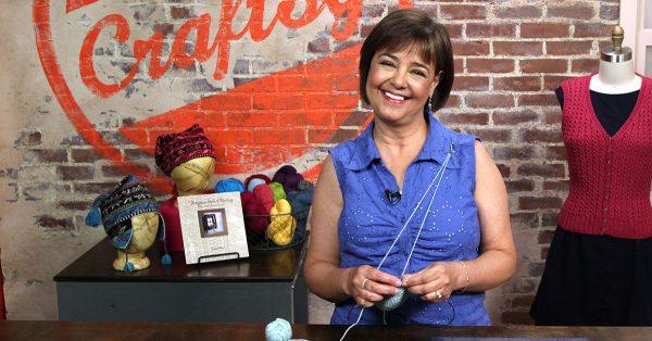 Woman holding a ball of light blue yarn