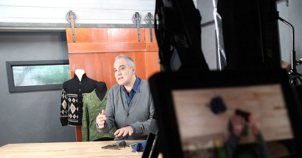 Man talking at a large table