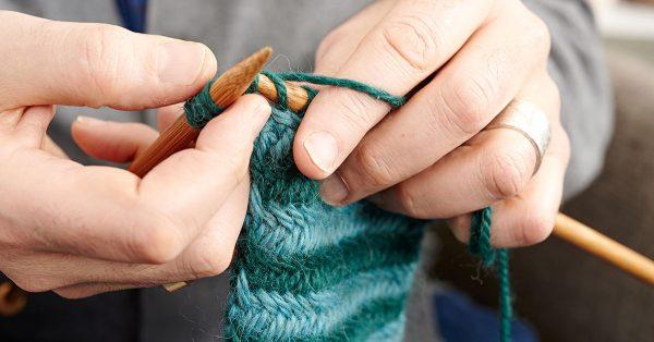 Knitting with green yarn