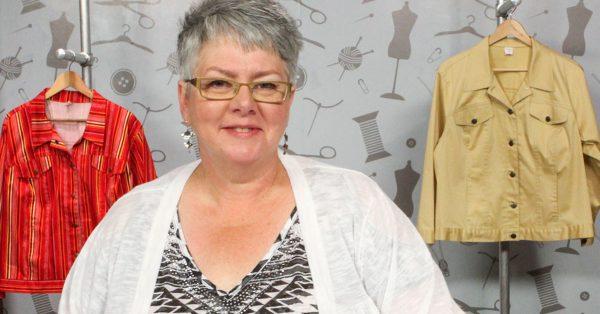 Older woman with short grey hair looking at the camera