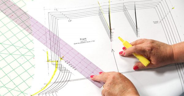 Person holding a ruler