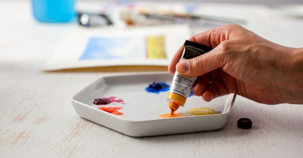 Pouring paint onto a dish