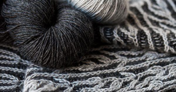 Close up of light and dark grey yarn