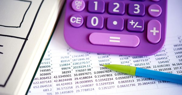 Sheet of numbers and a purple calculator