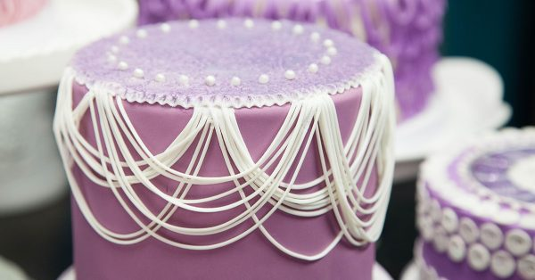 Purple cake with white decorations