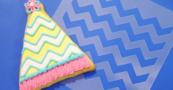 Birthday hat decorated sugar cookie