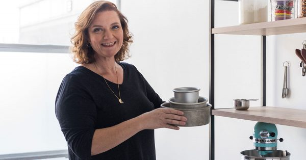 Woman holding different size cake pans