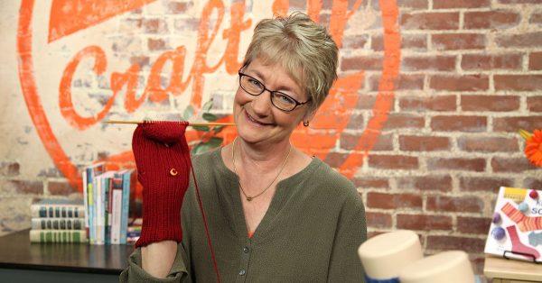Knitting a red mitten