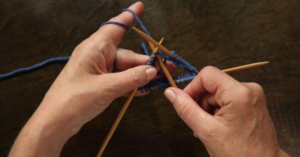 Knitting with blue yarn