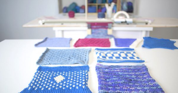 Blue, pink, purple and white knit squares around a table