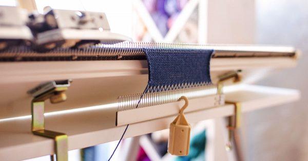 Machine knitting with navy yarn