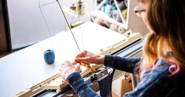 Woman machine knitting