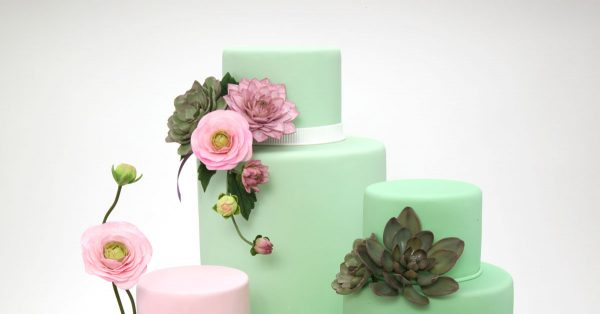 Cakes decorated with flowers and greenery