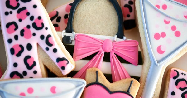 Sugar cookies decorated like shoes, purses and drinks
