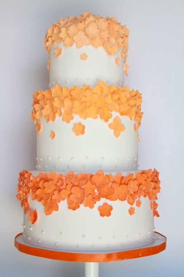 Tiered White Cake with Ruffled Orange Flowers