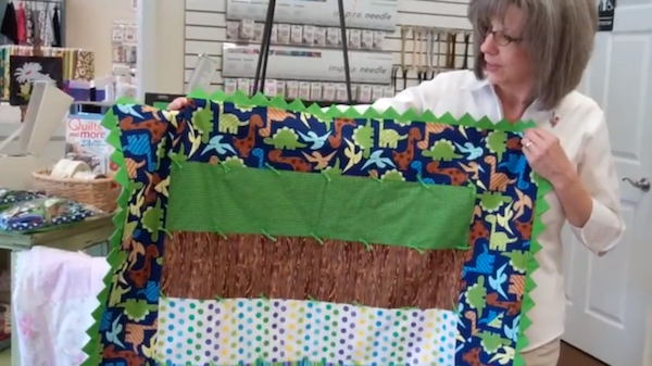 Woman Holding Quilt with Prairie Points