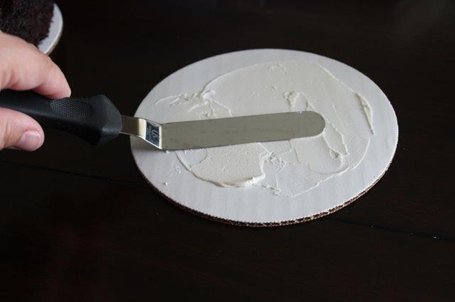 Buttercream Being Spread on a Cake Board with an Offset Spatula