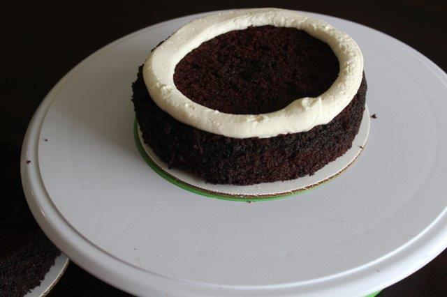 Piped Circle of Buttercream on a Chocolate Cake