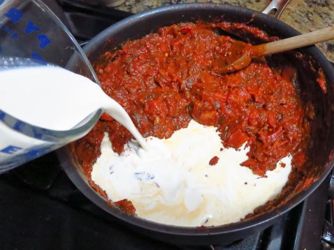 Adding the cream to chicken tikka masala