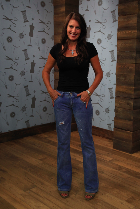 Angela Wolf Modeling a Pair of Distressed Denim Jeans