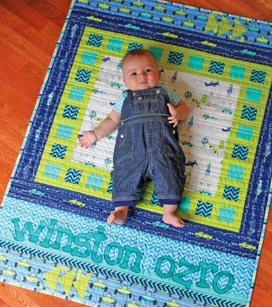 Baby Boy Laying on a Baby Quilt