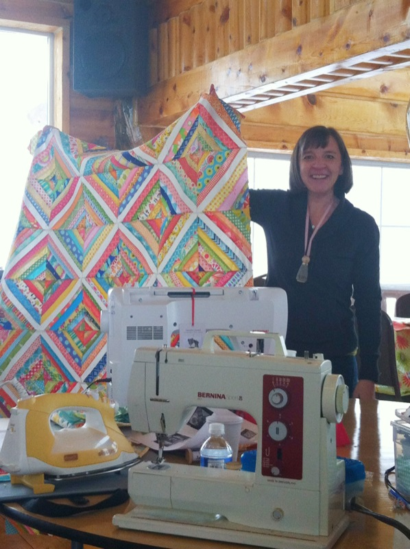Woman Showing off a Quilt - Quilt Retreat