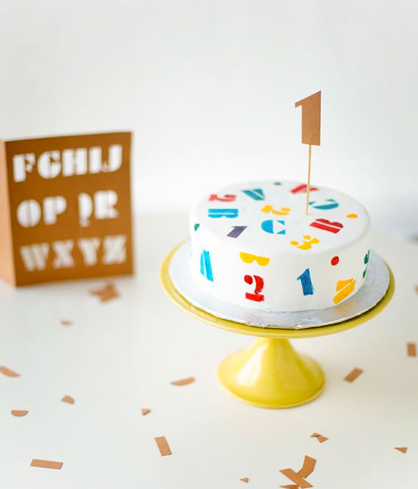 Colorful ABC and 123 Stenciled 1st Birthday Cake