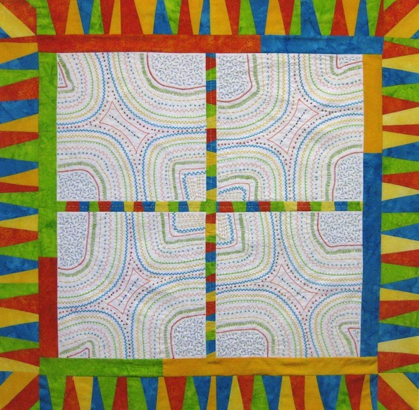 Brightly Colored Improve Pieced Quilt
