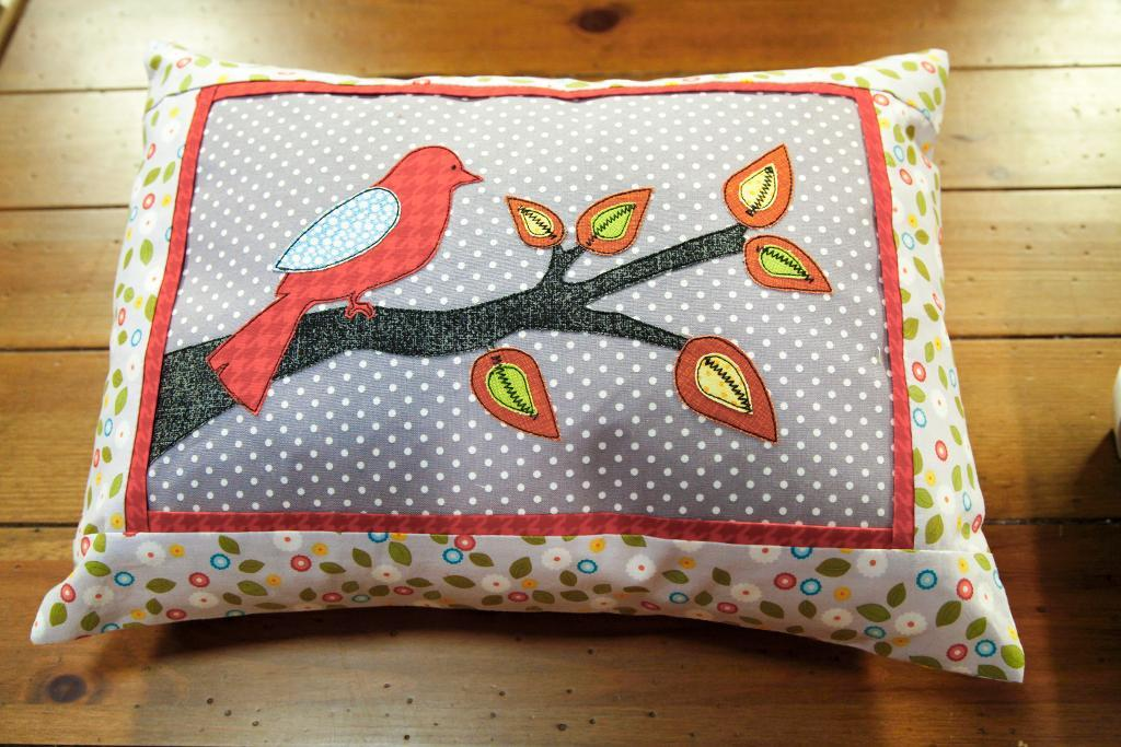 Pillow with an Embroidered Bird on It