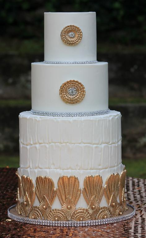 White and Gold Three-Tiered Cake by Joshua John Russell