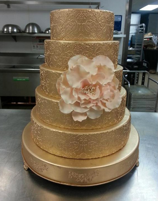 Stenciled Gold Wedding Cake with Pink Sugar Flower