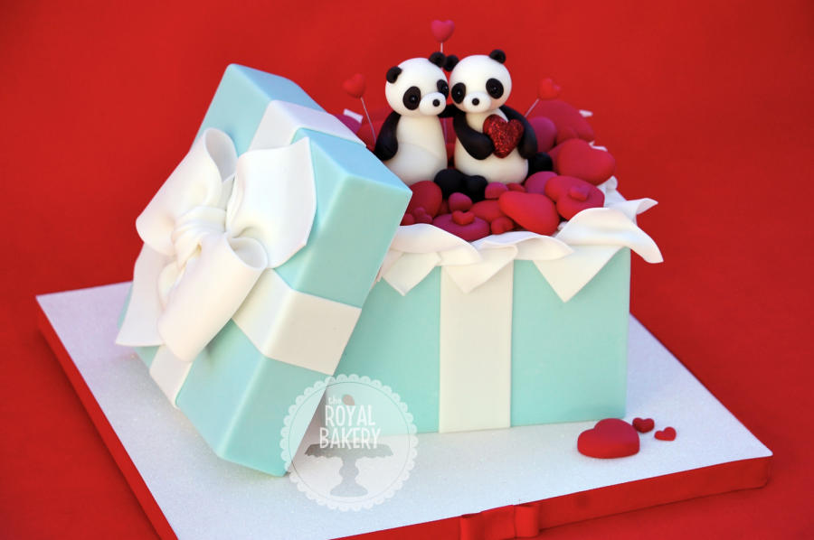 Two Pandas and Hearts Cake