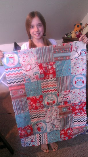 11-Year-Old Quilter Showing Her Completed Quilt