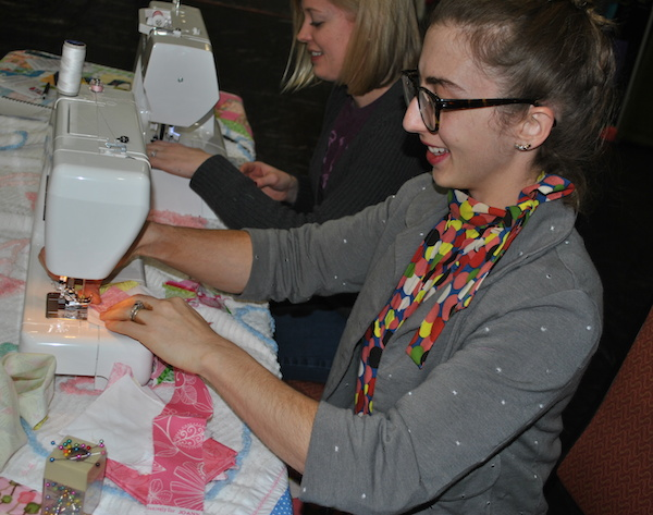 Women Sewing at a Quilting Retreat