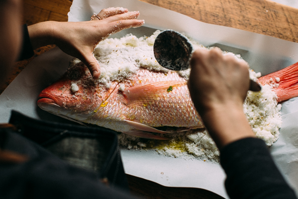 Covering Fish in Seasoning and Salt