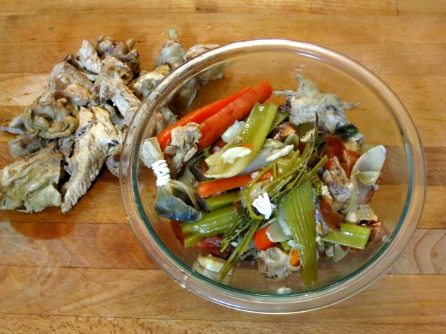 Discard aromatics and chicken bones before serving the soup.