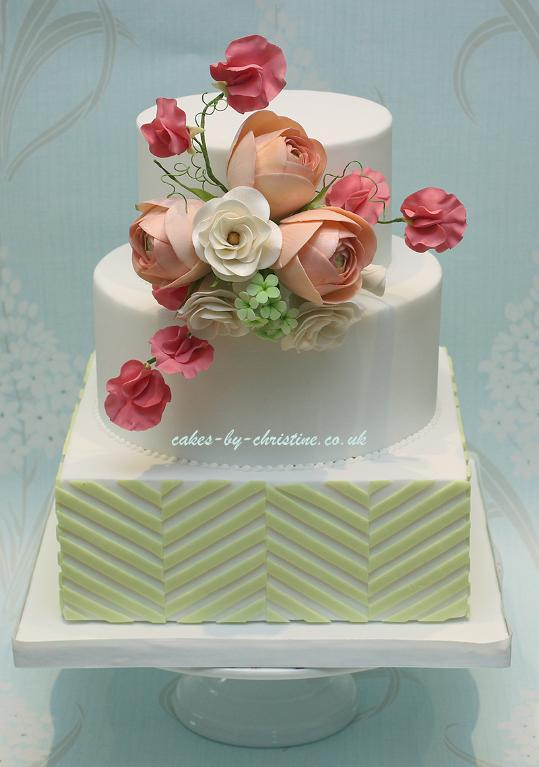Cake Decorated With Offset Stripes and Sugar Flowers