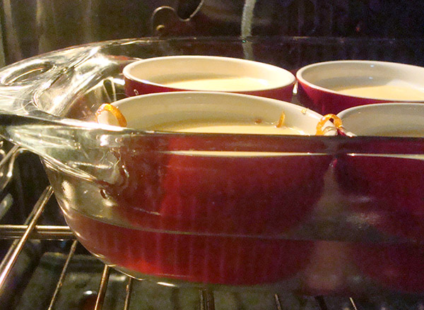 Flan in Ramekins Baking in the Oven
