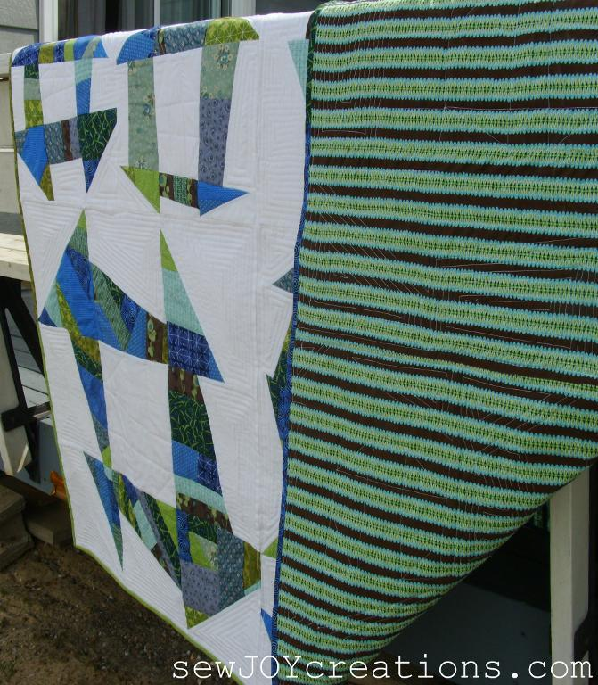 Liberated Churn Dash Quilt - Pattern available on Craftsy