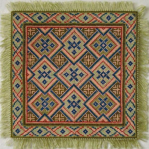 Mini needlepoint rug with geometric pattern