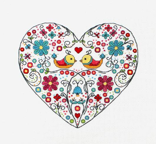 Cross stitch pattern of two birds and flowers inside a heart