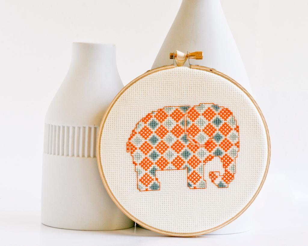 Cross-stitch pattern of an elephant filled with geometric shapes