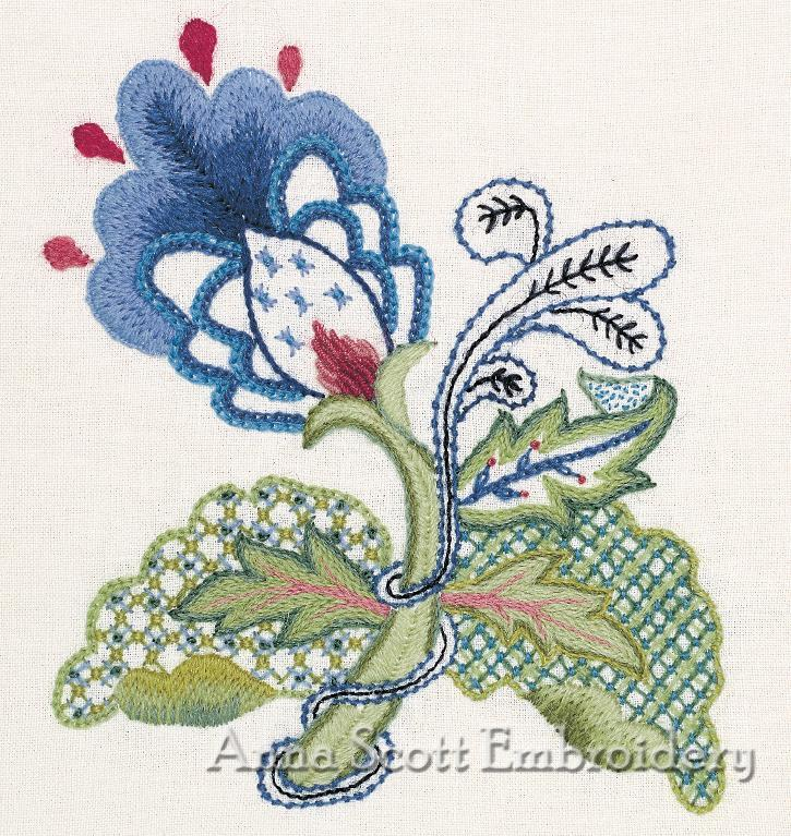 blue flower in crewel work embroidery