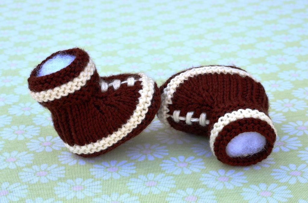 Knitted football baby booties