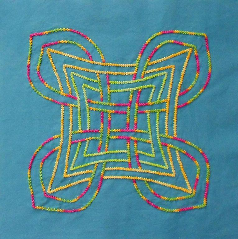 celtic knot embroidery in rainbow floss on turquoise background